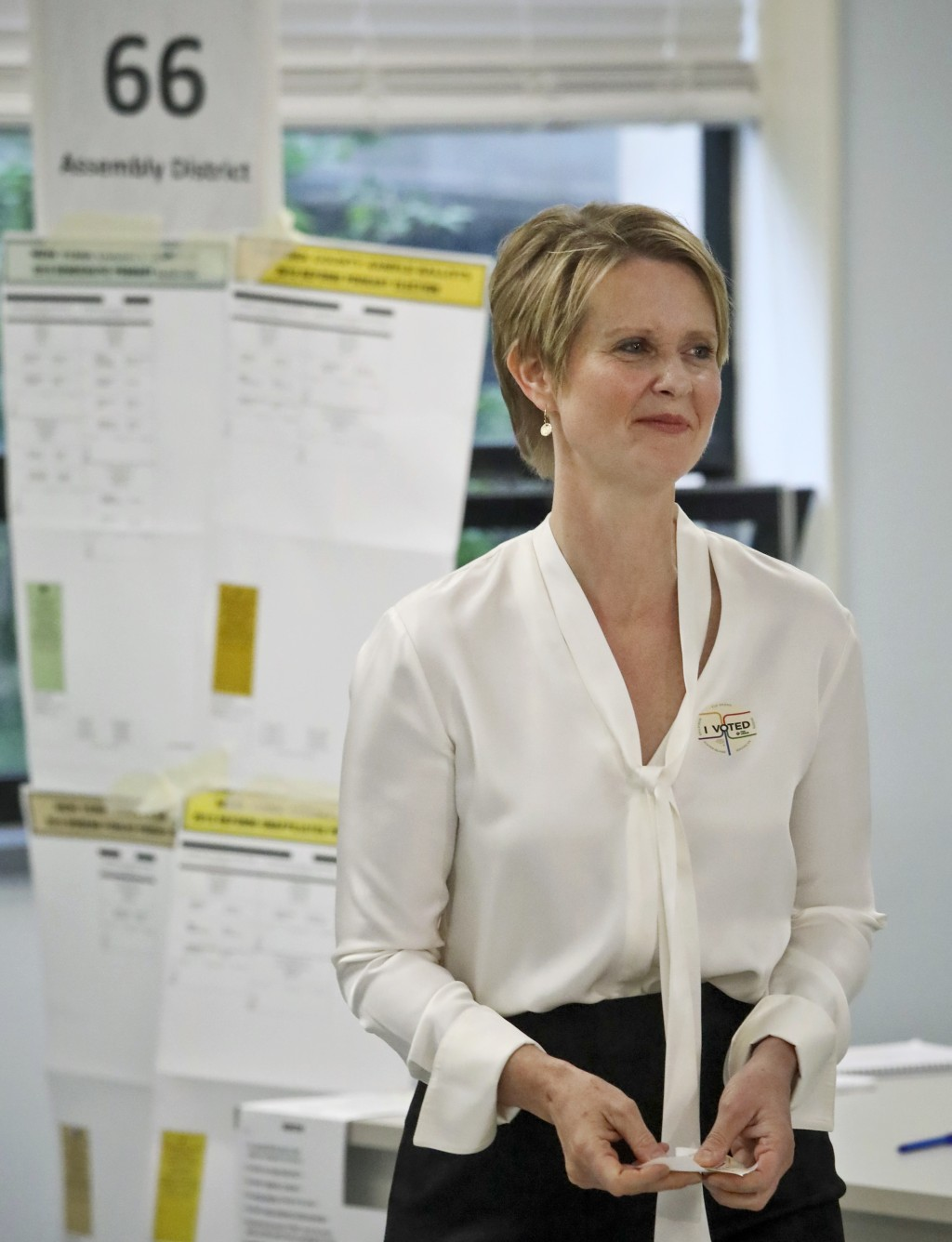 New York gubernatorial candidate Cynthia Nixon leaves a polling station after voting in the primary, Thursday Sept. 13, 2018, in New York. Democrats a