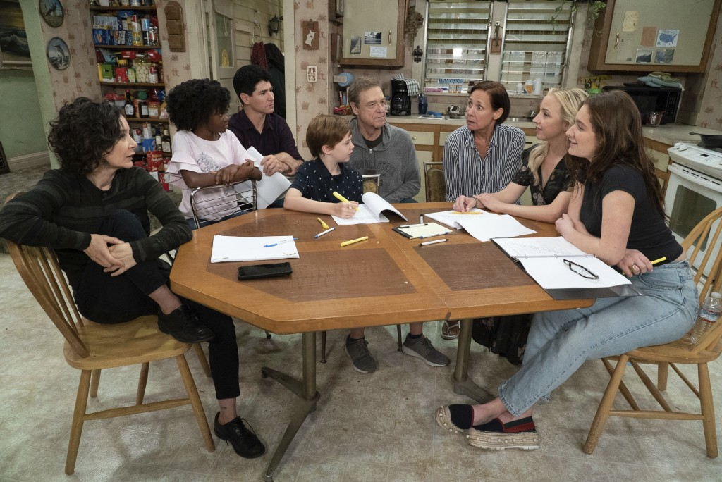 This image released by ABC shows, from left, Sara Gilbert, Jayden Rey, Michael Fishman, Ames McNamara, John Goodman, Laurie Metcalf, Lecy Goranson and
