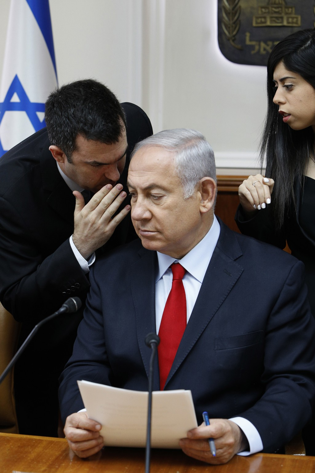 FILE - In this July 23, 2018 file photo, Israeli Prime Minister Benjamin Netanyahu listens to his spokesman David Keyes as he opens the weekly cabinet