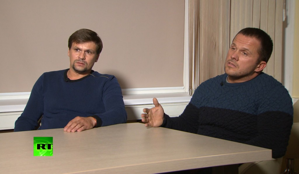 In this video grab provided by the RT channel , Ruslan Boshirov, left, and Alexander Petrov attend their first public appearance in an interview with