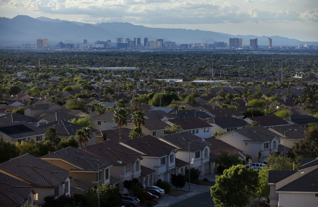 In this April 12, 2016, photo, the Las Vegas Strip is seen in the distance from Unicorn Hills Drive in the unfinished Unicorn Hills development in Hen