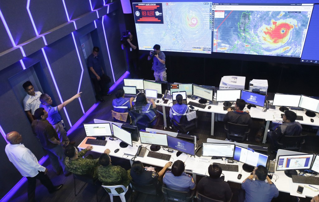 Philippine President Rodrigo Duterte, second from left, observes the National Disaster Risk Reduction and Management Council operation center in metro