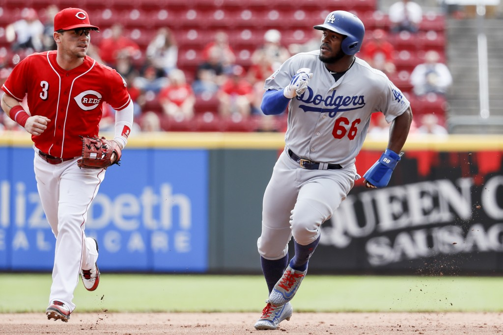 Los Angeles Dodgers' Yasiel Puig (66) runs to third on a double hit by Joc Pederson off Cincinnati Reds starting pitcher Anthony DeSclafani in the fif