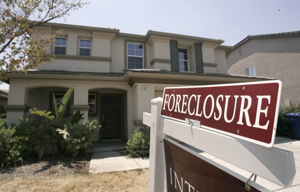 FILE- This July 2, 2008, file photo shows a foreclosed home in Sacramento, Calif. As home values plummeted after the housing bubble burst in 2007, man