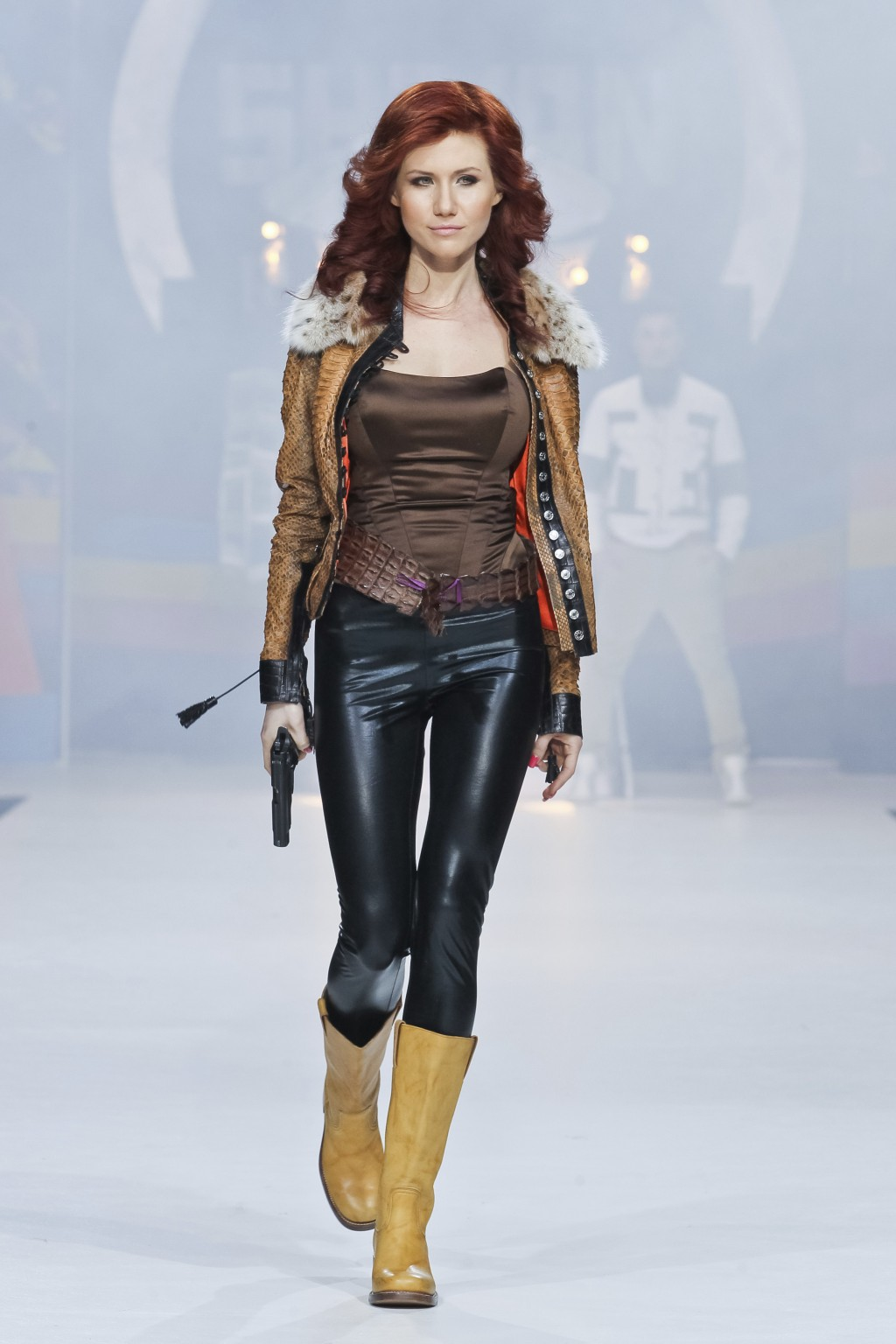 FILE. In this file photo taken on Sunday, April 3, 2011, Anna Chapman, who was deported from the U.S. on charges of espionage, displays a creation by
