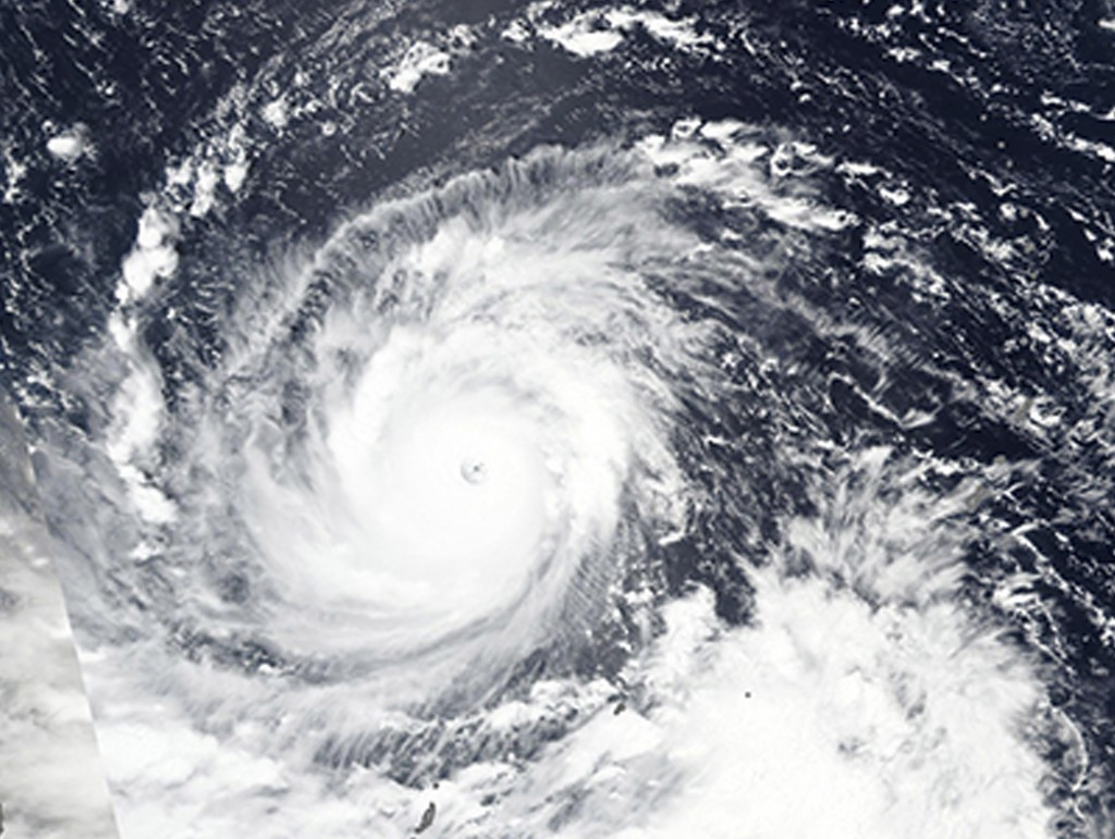 In this Wednesday, Sept. 12, 2018, NASA satellite image, Super Typhoon Mangkhut churns west towards the Philippines. Philippine officials have begun e
