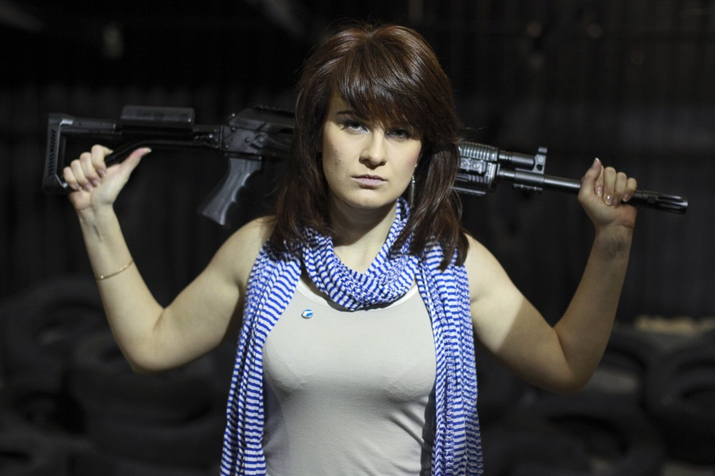 FILE - In this Sunday, April 22, 2012 filer, Maria Butina, a gun-rights activist, poses for a photo at a shooting range in Moscow, Russia. Accused of