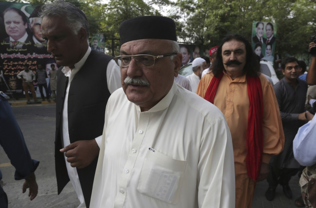 Pakistani politician Mian Iftikhar, center, arrives at a residence of Pakistan's former prime minister Nawaz Sharif to offer condolences for the death