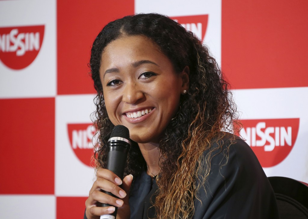 In this Thursday, Sept. 13, 2018, file photo, Naomi Osaka,  the champion of U.S. Open women's singles,  smiles during a press conference in Yokohama. ...