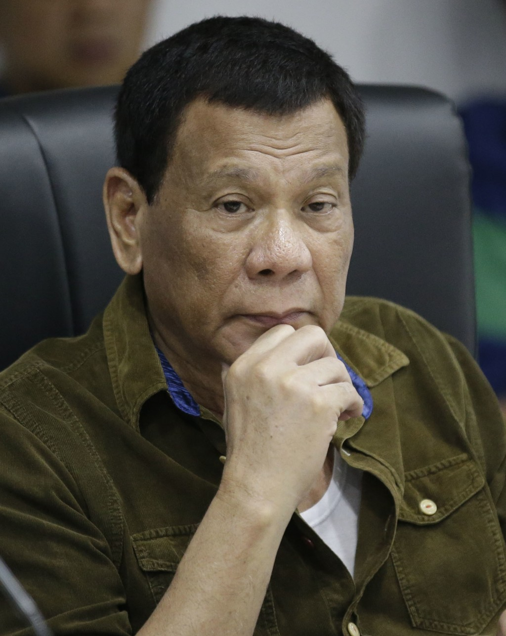 Philippine President Rodrigo Duterte listens during a command conference on Typhoon Mangkhut, locally named Typhoon Ompong, at the National Disaster R