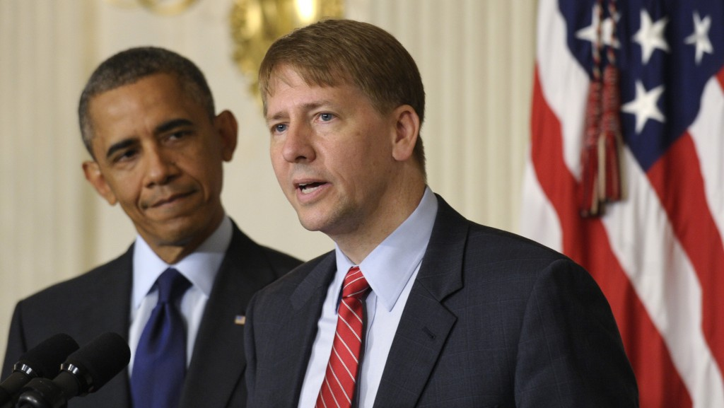 FILE - In this July 17, 2013 file photo, President Barack Obama, left, listens as Richard Cordray, right, the new director of the Consumer Financial P