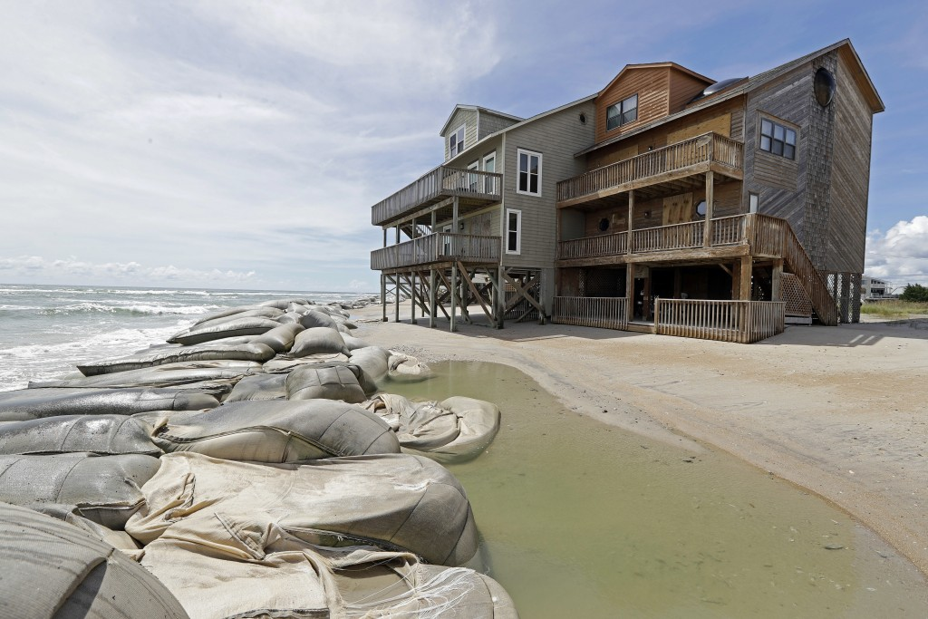 Sand bags surround homes on North Topsail Beach, N.C., Wednesday, Sept. 12, 2018 as Hurricane Florence threatens the coast. (AP Photo/Chuck Burton)