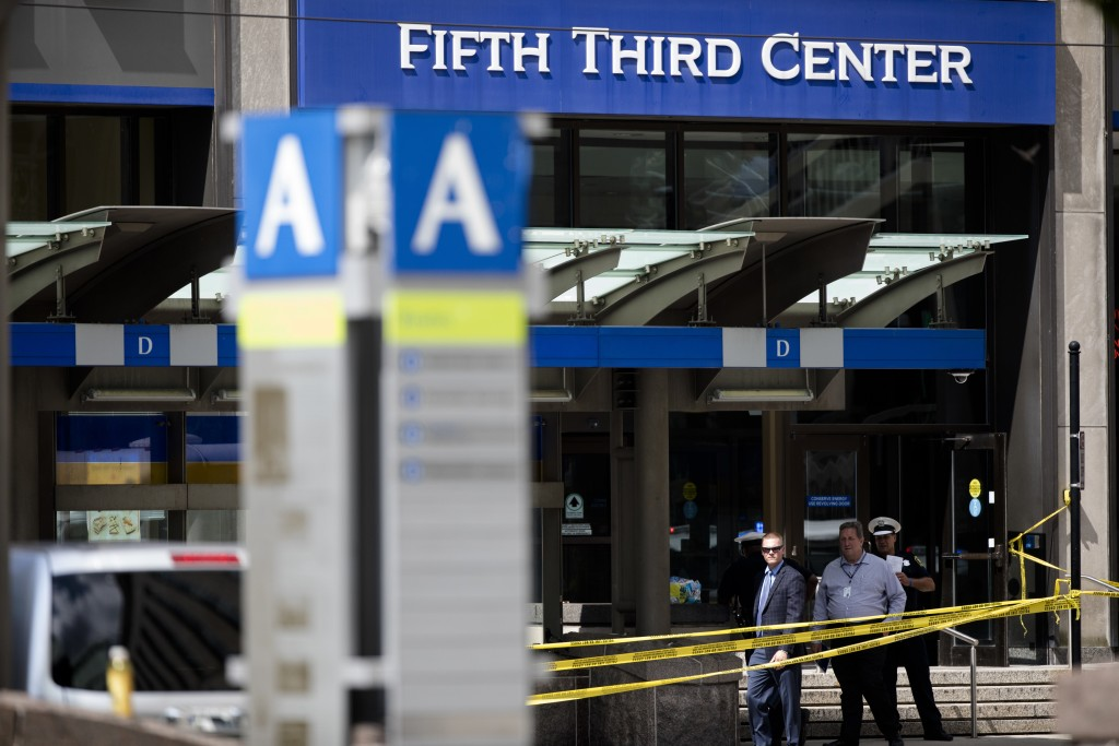 FILE - In this Sept. 6, 2018 file photo, police investigate outside Fifth Third Bank building on Fountain Square after a shooting with multiple fatali