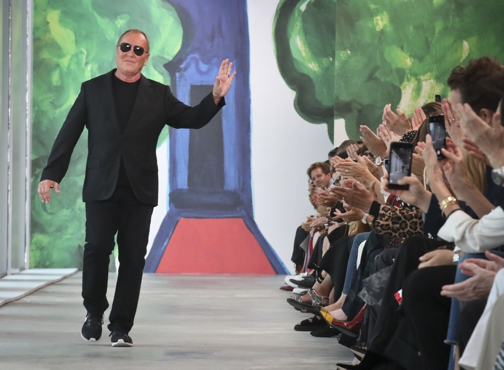 Fashion designer Michael Kors acknowledges applause after unveiling his latest collection during Fashion Week, Wednesday, Sept. 12, 2018, in New York.