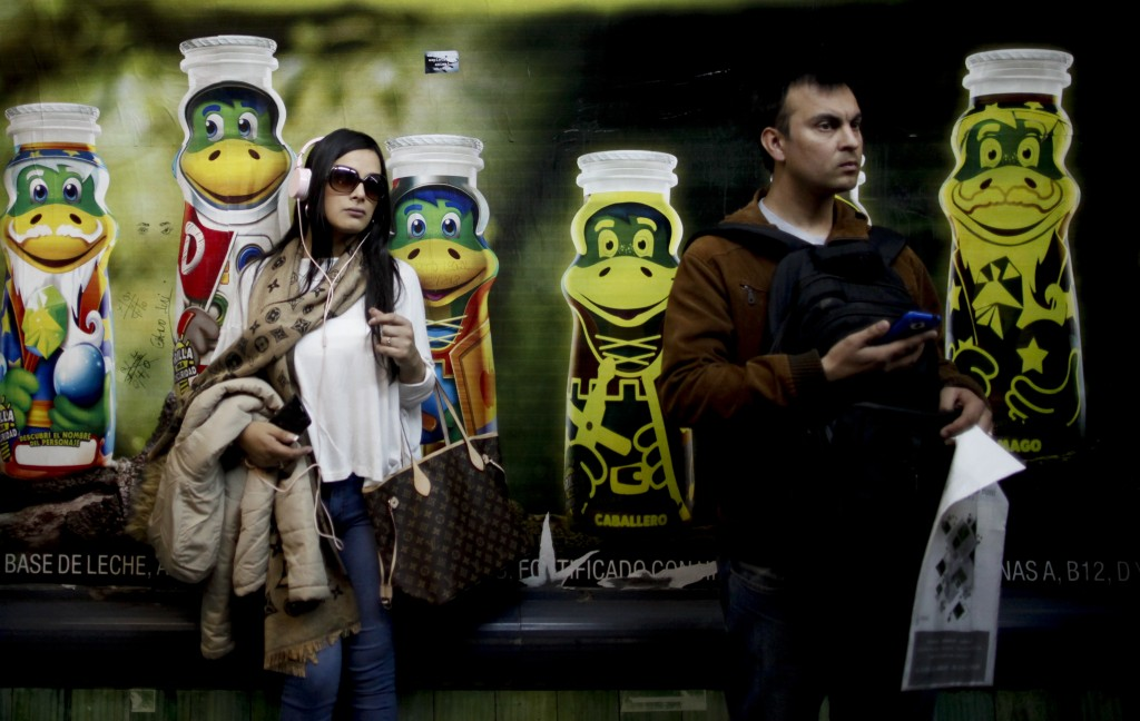 People wait for the subway in Buenos Aires, Argentina, Wednesday, Sept. 12, 2018. (AP Photo/Natacha Pisarenko)