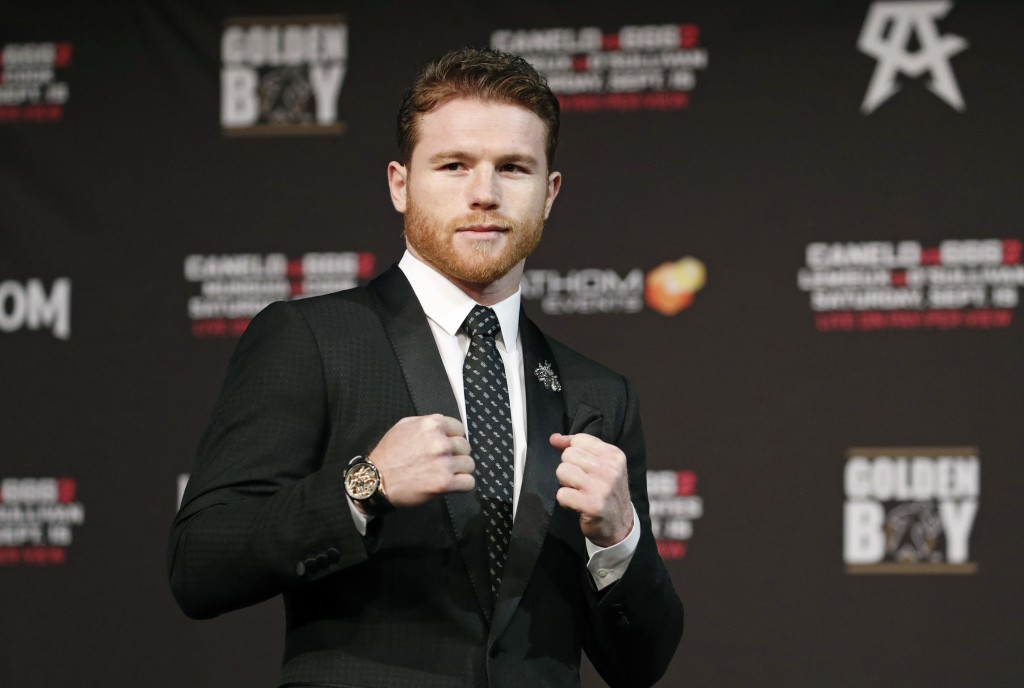 Canelo Alvarez poses during a news conference Wednesday, Sept. 12, 2018, in Las Vegas. Alvarez is scheduled to fight Gennady Golovkin in a title bout