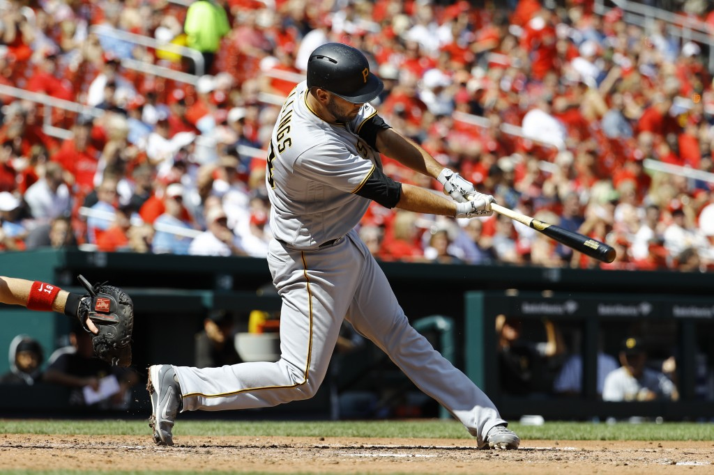Pittsburgh Pirates' Jacob Stallings hits a two-RBI single, driving in Jordan Luplow and Pablo Reyes during the sixth inning of a baseball game against...