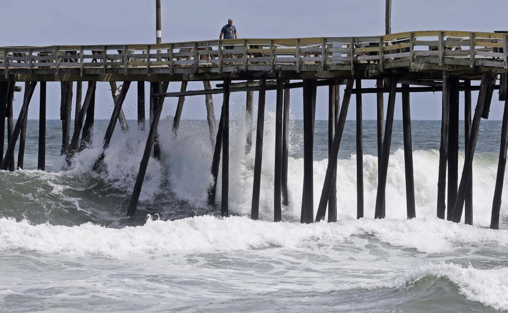 Waves crash under a pier in Kill Devil Hills, N.C., Wednesday, Sept. 12, 2018, as Hurricane Florence approaches the east coast. (AP Photo/Gerry Broome