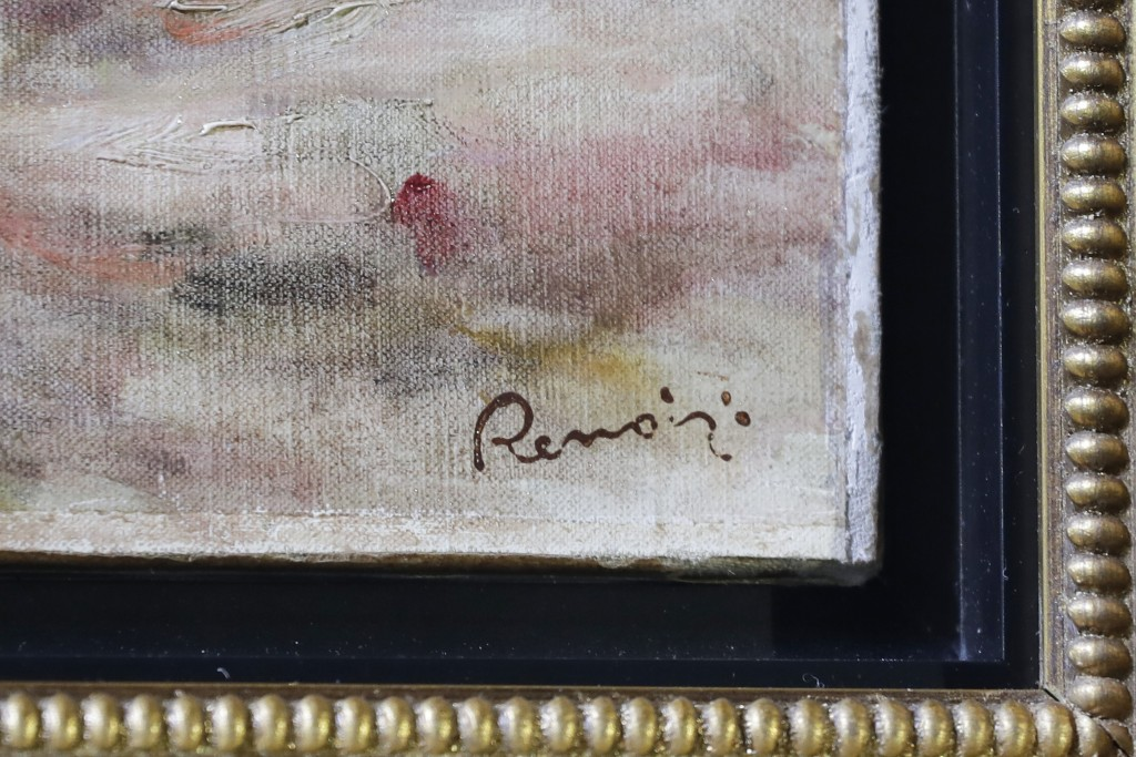 "Renoir's signature is visible in the corner of his painting ""Femmes Dans Un Jardin"" at a news conference, Wednesday, Sept. 12, 2018, in New York. The"