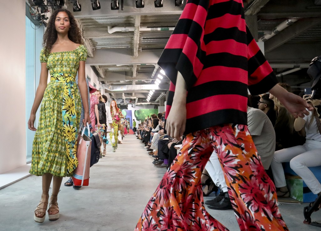 Fashion from the Michael Kors collection is modeled during Fashion Week, Wednesday Sept. 12, 2018 in New York. (AP Photo/Bebeto Matthews)