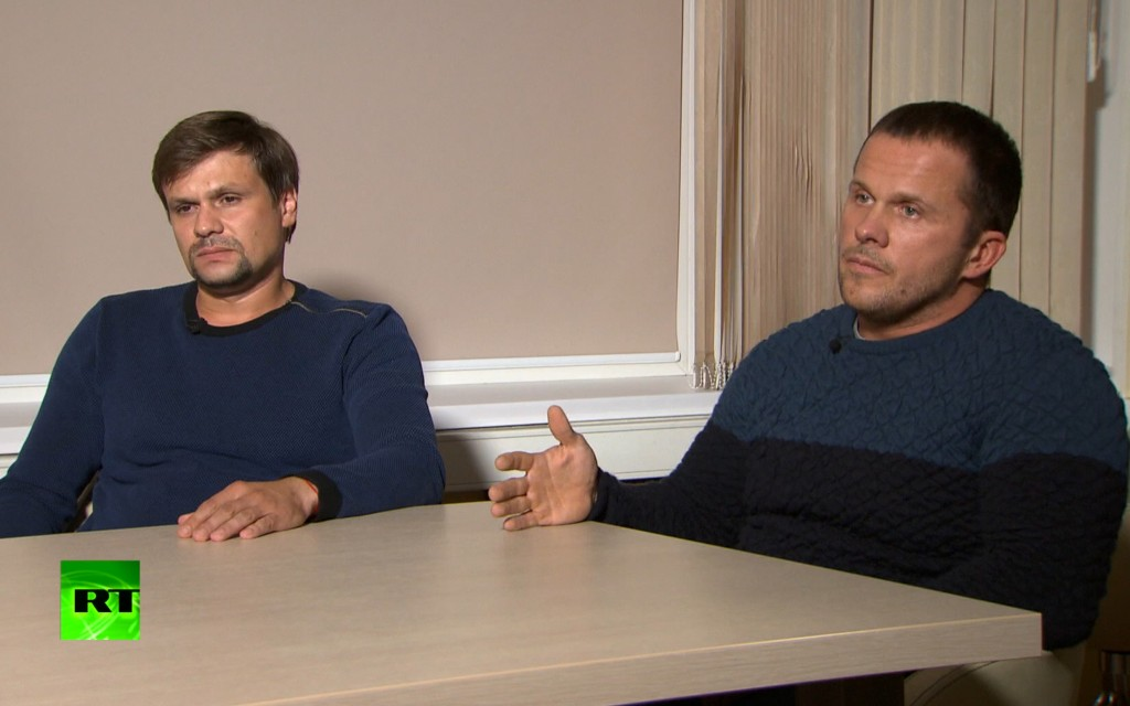 In this video grab provided by the RT channel , Ruslan Boshirov, left, and Alexander Petrov attend their first public appearance in an interview with ...