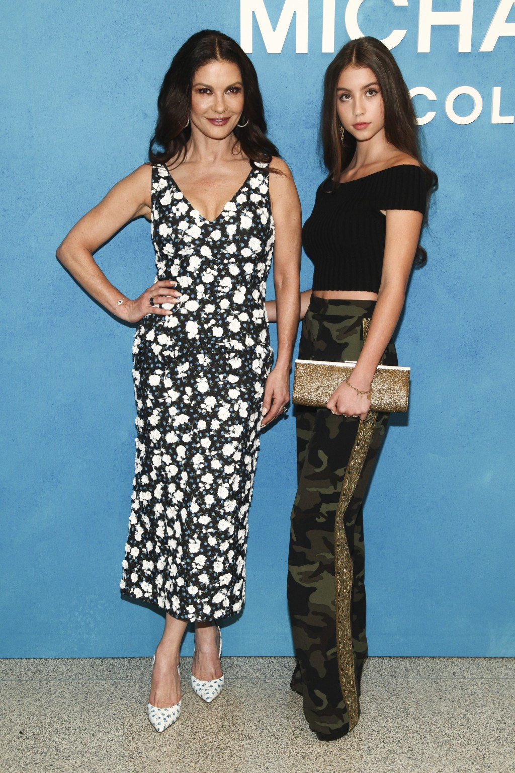 Catherine Zeta-Jones, left, and Carys Zeta Douglas, right, attend the NYFW Spring/Summer 2019 Michael Kors fashion show at Pier 17 on Wednesday, Sept.