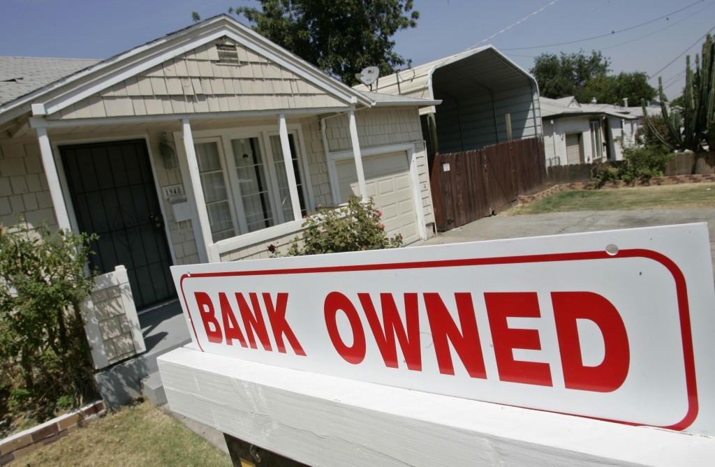 FILE- This Aug. 14, 2007, file photo shows a sign of a house under foreclosure in Antioch, Calif. As home values plummeted after the housing bubble bu