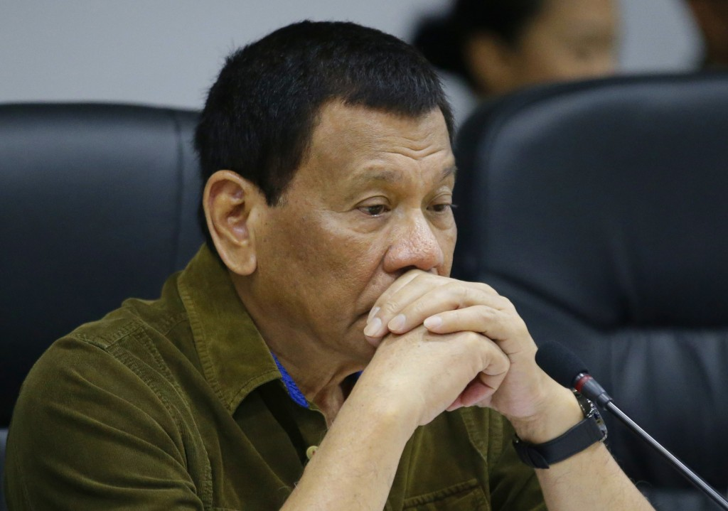 Philippine President Rodrigo Duterte attends a command conference at the National Disaster Risk Reduction and Management Council operations center in