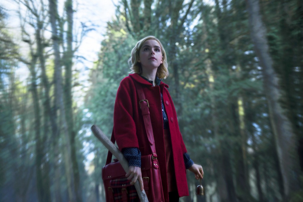 "This image released by Netflix shows Kiernan Shipka in a scene from ""Chilling Adventures of Sabrina,"" premiering on Oct. 26. (Diyah Pera/Netflix via A"