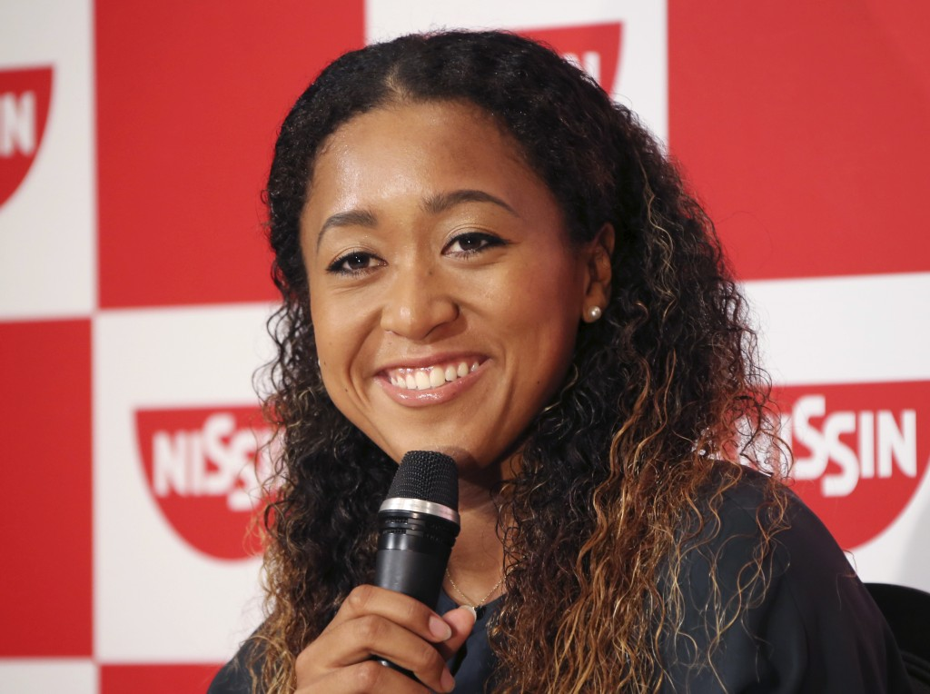 Naomi Osaka,  the champion of U.S. Open women's singles, smiles during a press conference in Yokohama, Thursday, Sept. 13, 2018. Osaka defeated Serena...