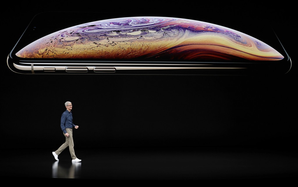 Apple CEO Tim Cook speaks about the Apple iPhone XS at the Steve Jobs Theater during an event to announce new Apple products Wednesday, Sept. 12, 2018