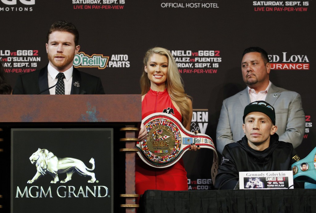 Canelo Alvarez, left, speaks during a news conference as Gennady Golovkin listens Wednesday, Sept. 12, 2018, in Las Vegas. The two are scheduled to fi
