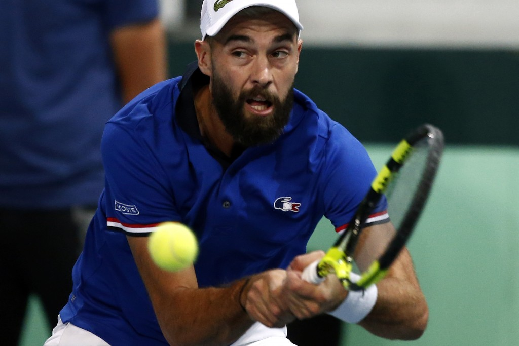 France's Benoit Paire returns the ball to Spain's Pablo Carreno Busta during the Davis Cup semifinals France against Spain, Friday, Sept.14, 2018 in L