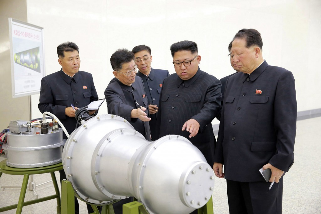 FILE - This undated file photo distributed on Sept. 3, 2017 by the North Korean government, shows North Korean leader Kim Jong Un, second from right,