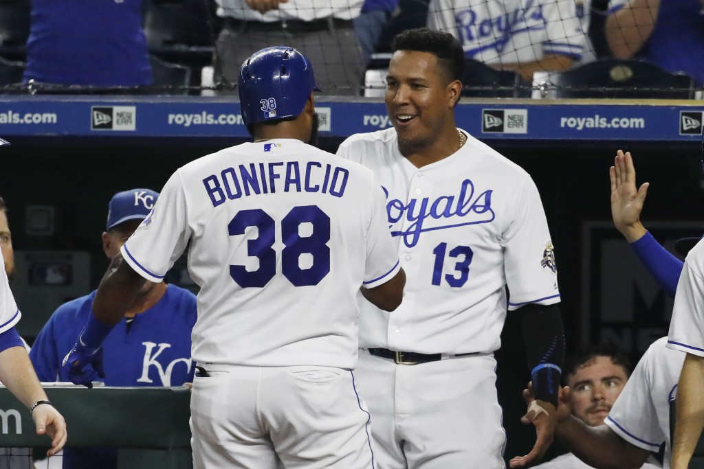 Kansas City Royals' Jorge Bonifacio (38) is congratulated by Salvador Perez (13) after hitting a solo home run in the sixth inning of a baseball game