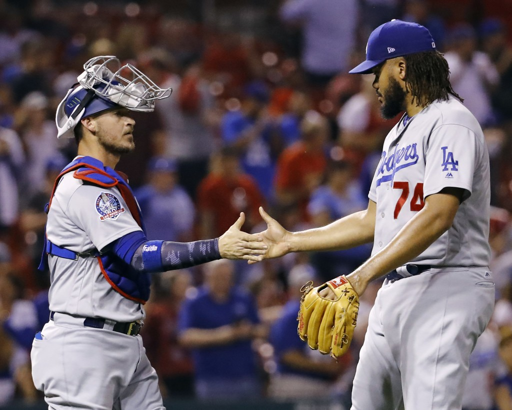 Los Angeles Dodgers catcher Yasmani Grandal, left, and relief pitcher Kenley Jansen celebrate after the last out in the ninth inning of a baseball gam