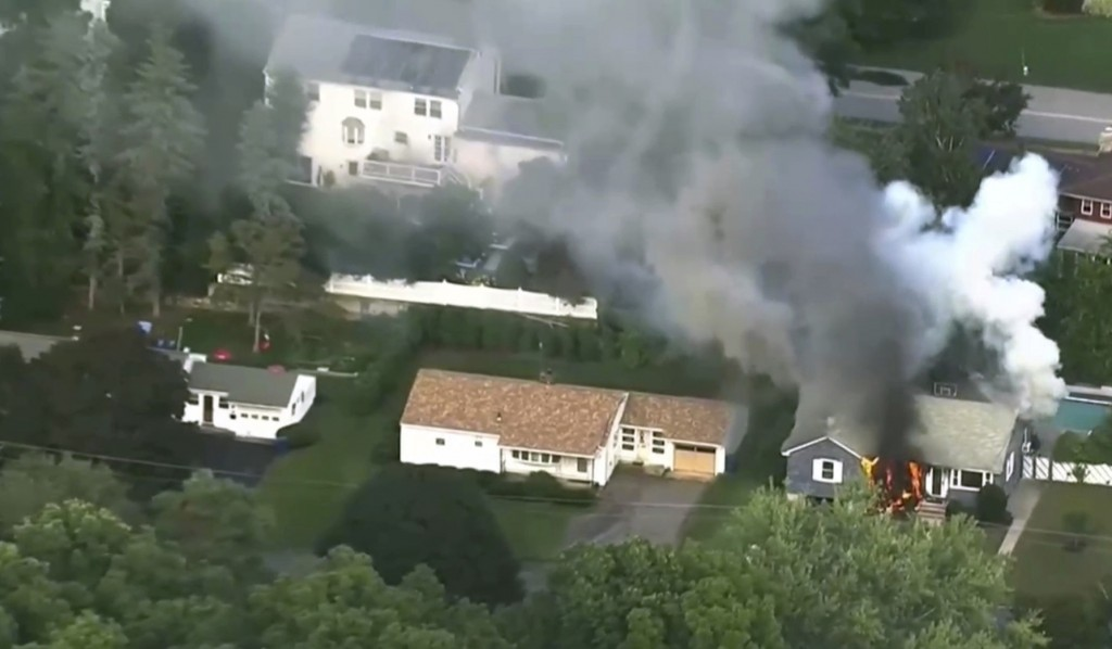 In this image take from video provided by WCVB in Boston, flames rise from a house in Lawrence, Mass, a suburb of Boston, Thursday, Sept. 13, 2018. Em...