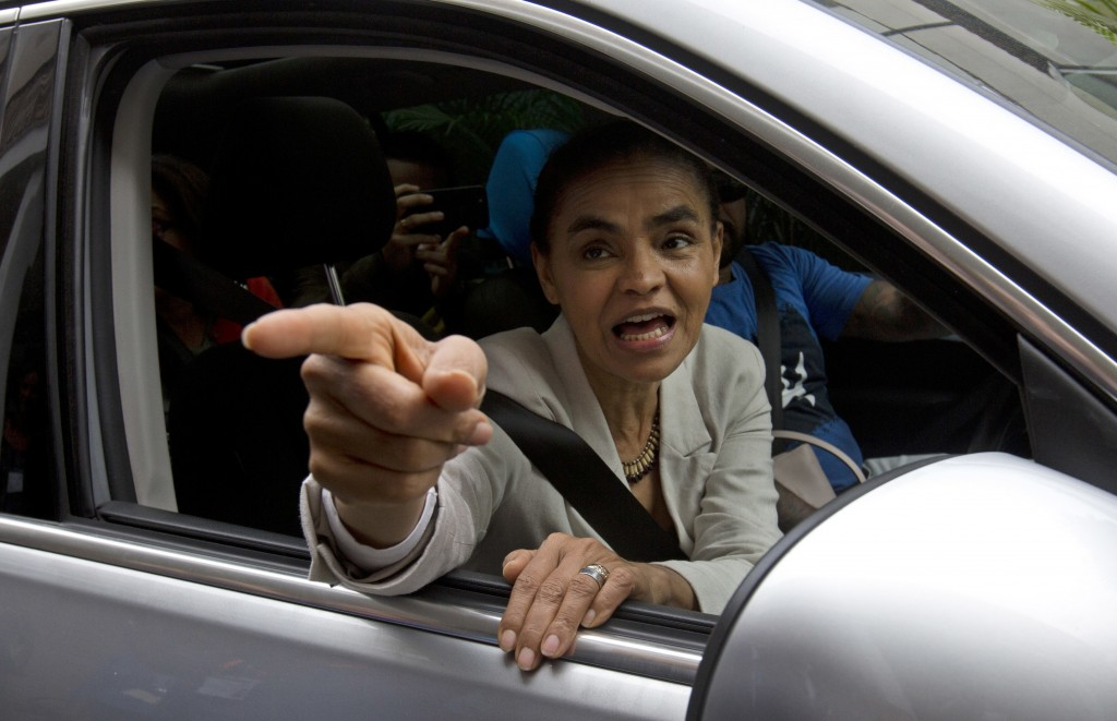 """In this Sept. 11, 2018 photo, Marina Silva, presidential candidate for the Sustainability Network Party, talks to supporters after visiting the """"Saude"""