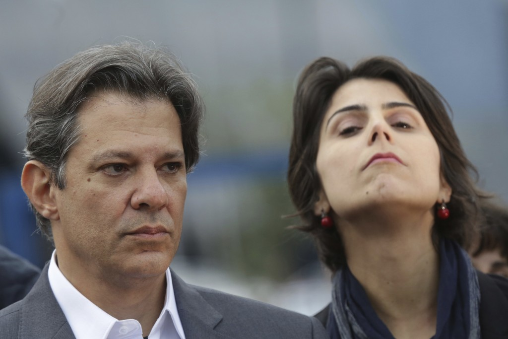 Workers' Party presidential candidate Fernando Haddad and his running-mate Manuela d'Avila hold a campaign rally outside federal police headquarters w