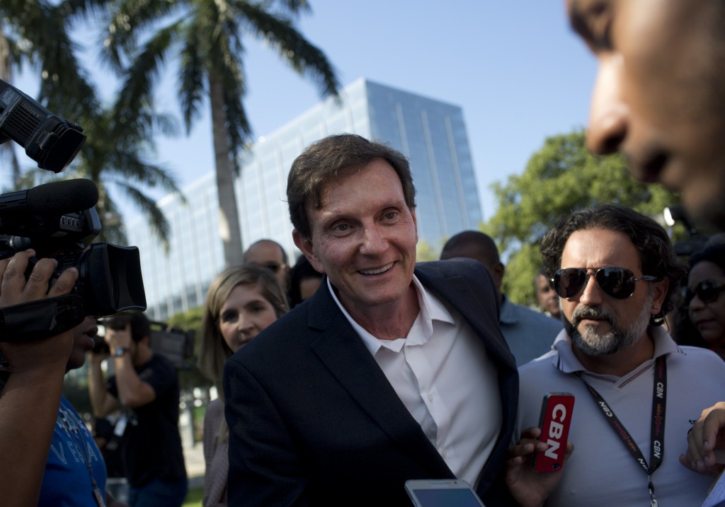 FILE - In this June 19, 2017 file photo, Mayor Marcelo Crivella talks with the media in Rio de Janeiro, Brazil. Evangelical voters helped propel Crive