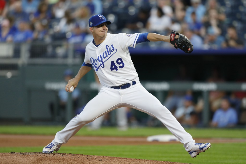 Kansas City Royals pitcher Heath Fillmyer throws to a Minnesota Twins batter in the first inning of a baseball game at Kauffman Stadium in Kansas City