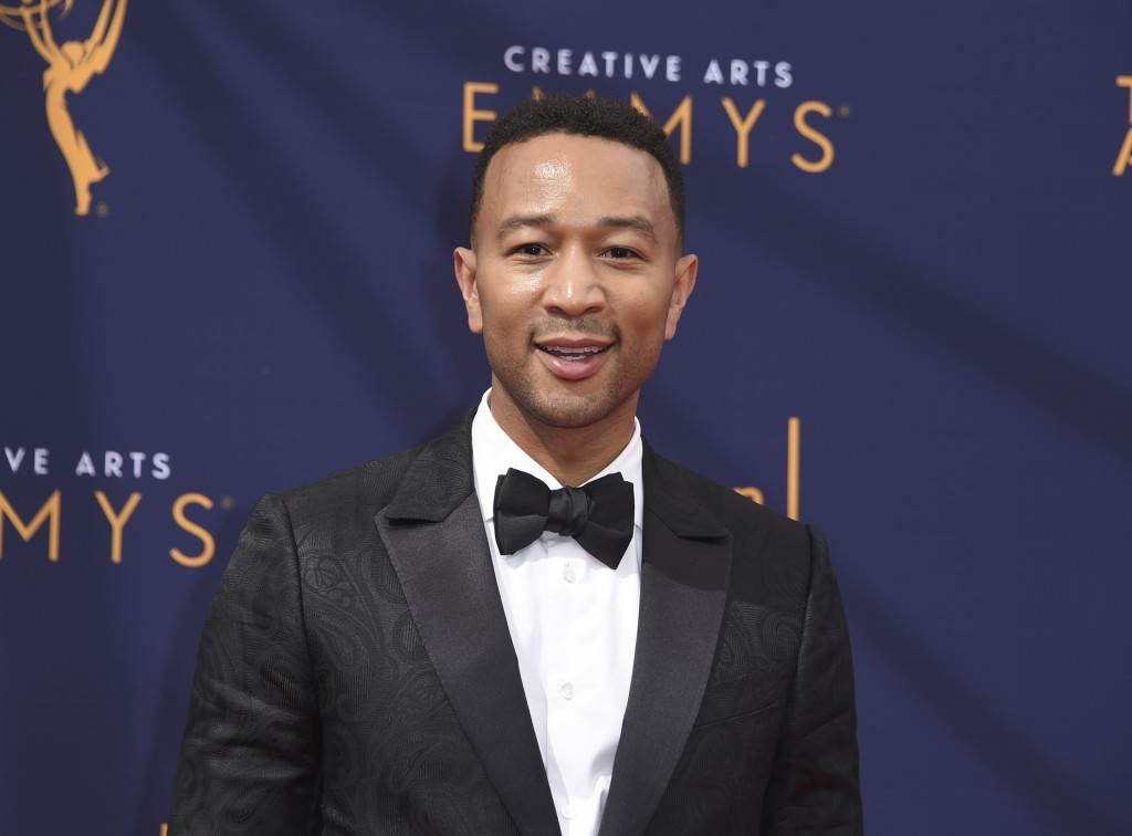 "FILE - In this Sept. 9, 2018 file photo, John Legend arrives at the Creative Arts Emmy Awards in Los Angeles. Legend will become a coach on NBC's ""The"