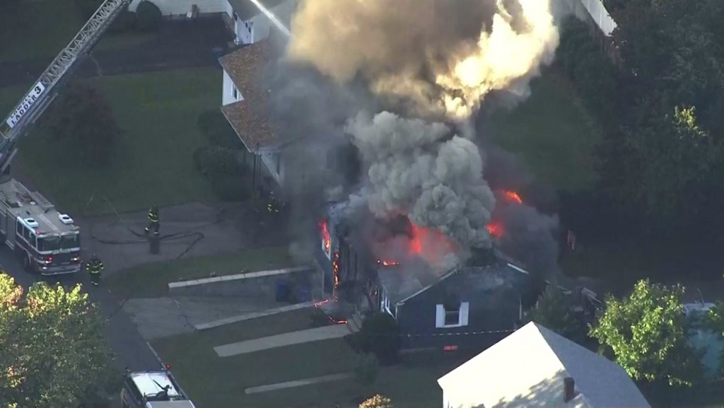 In this image take from video provided by WCVB in Boston, firefighters battle a raging house fire in Lawrence, Mass, a suburb of Boston, Thursday, Sep...