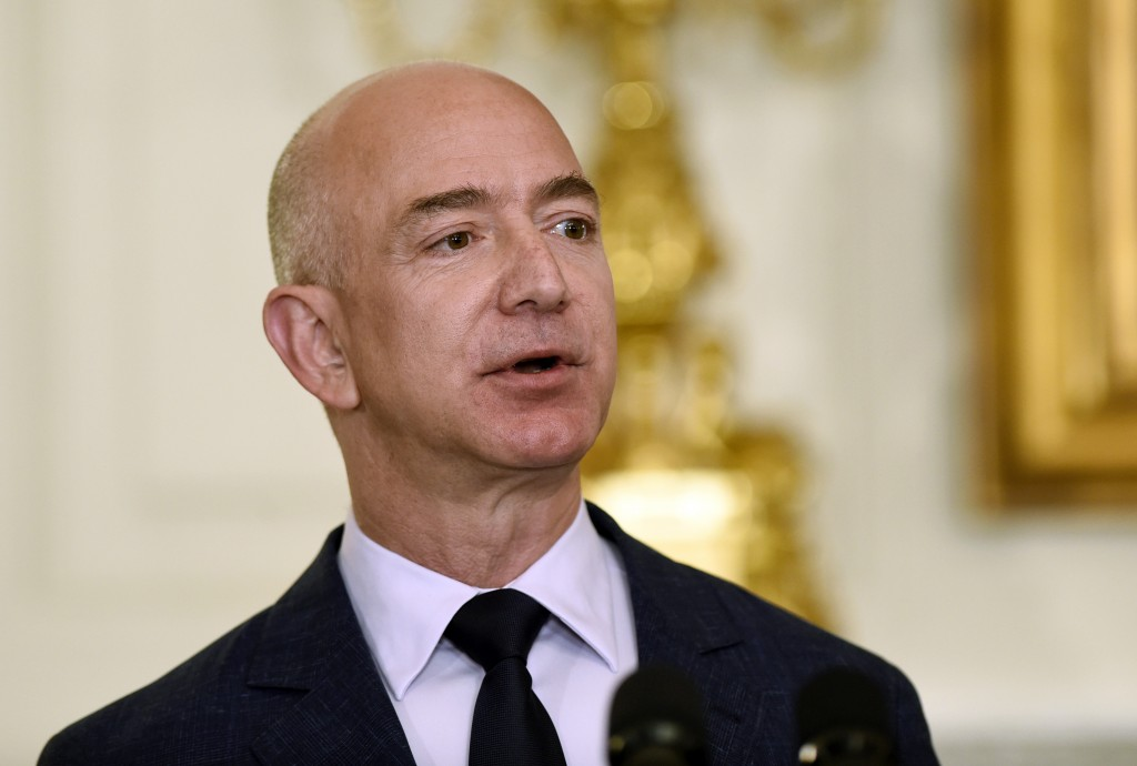 FILE - In this May 5, 2016, file photo, Jeff Bezos, the founder and CEO of Amazon.com, speaks in the State Dining Room of the White House in Washingto