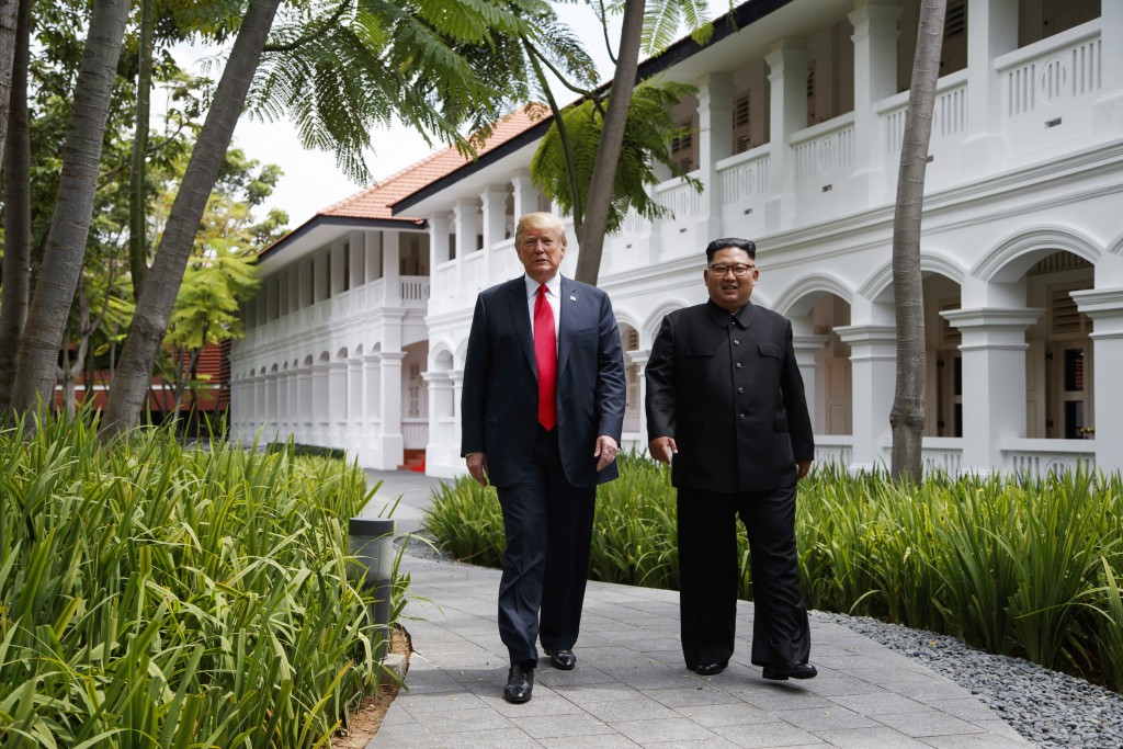FILE - In this June 12, 2018, file photo, President Donald Trump walks with North Korean leader Kim Jong Un on Sentosa Island in Singapore. In recent