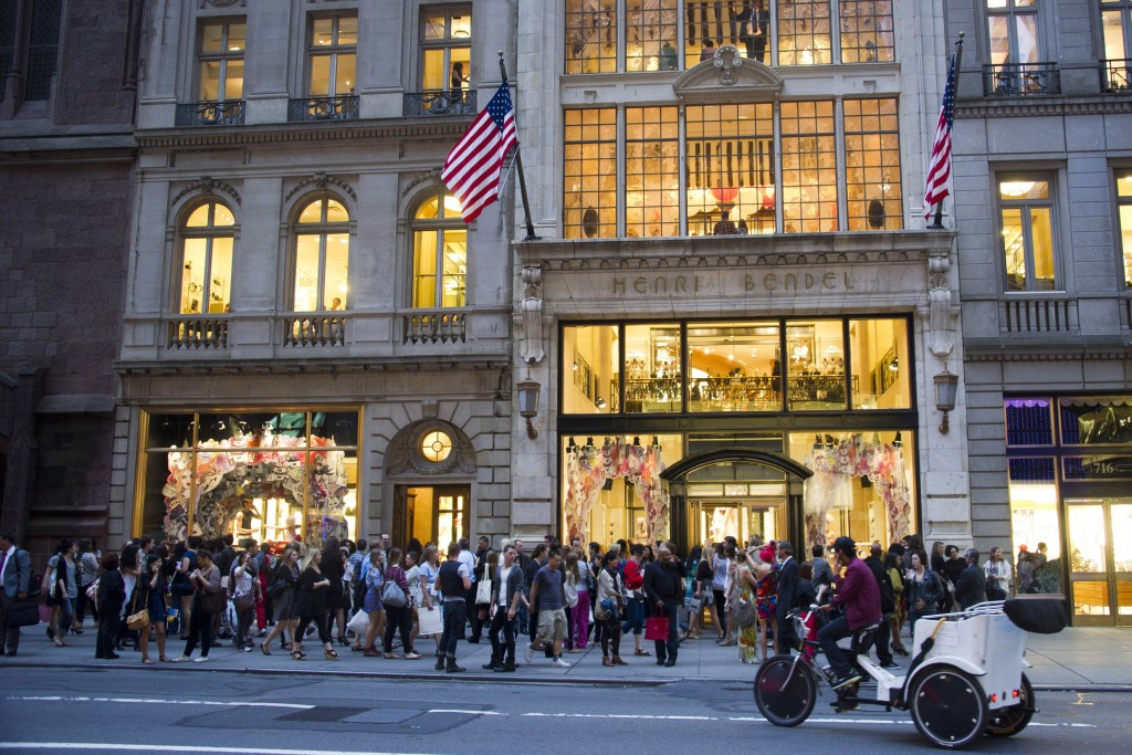 FILE- In this Sept. 8, 2011, file photo shoppers gather outside the Henri Bendel store on Fifth Avenue during Fashion's Night Out in New York. Henri B