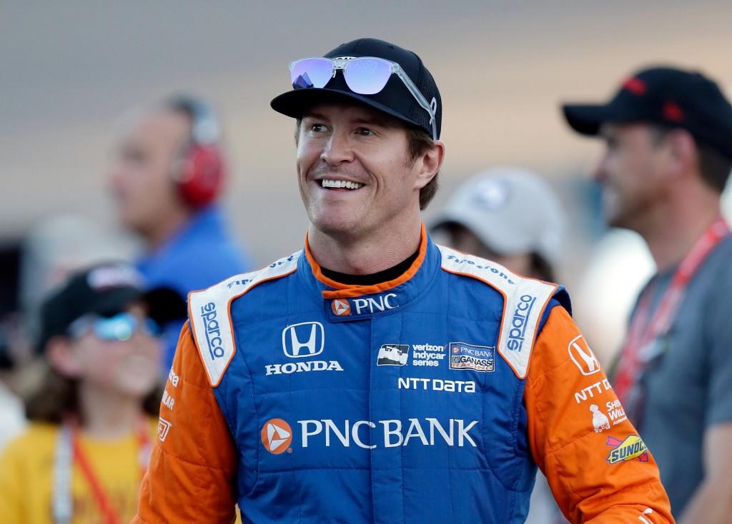 FILE - In this, April 7, 2018, file photo, driver Scott Dixon smiles before the IndyCar auto race at Phoenix International Raceway in Avondale, Ariz.