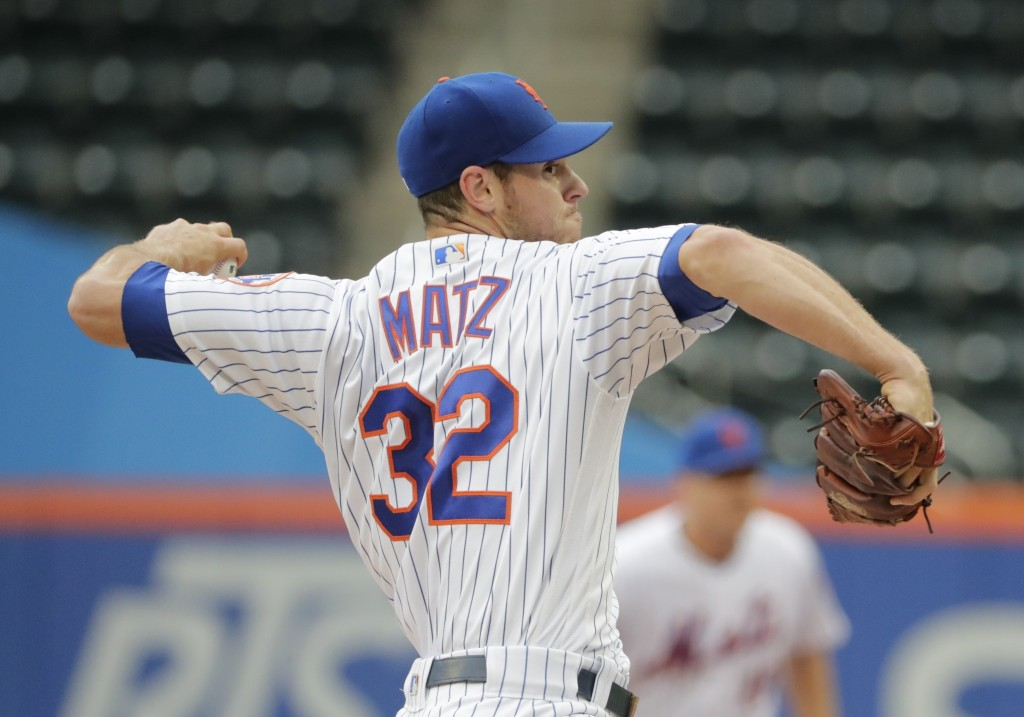 New York Mets' Steven Matz (32) delivers a pitch during the first inning in the first baseball game of a doubleheader against the Miami Marlins, Thurs
