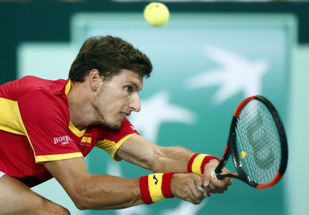 Spain's Pablo Carreno Busta returns the ball to France's Benoit Paire during the Davis Cup semifinals France against Spain, Friday, Sept.14, 2018 in L