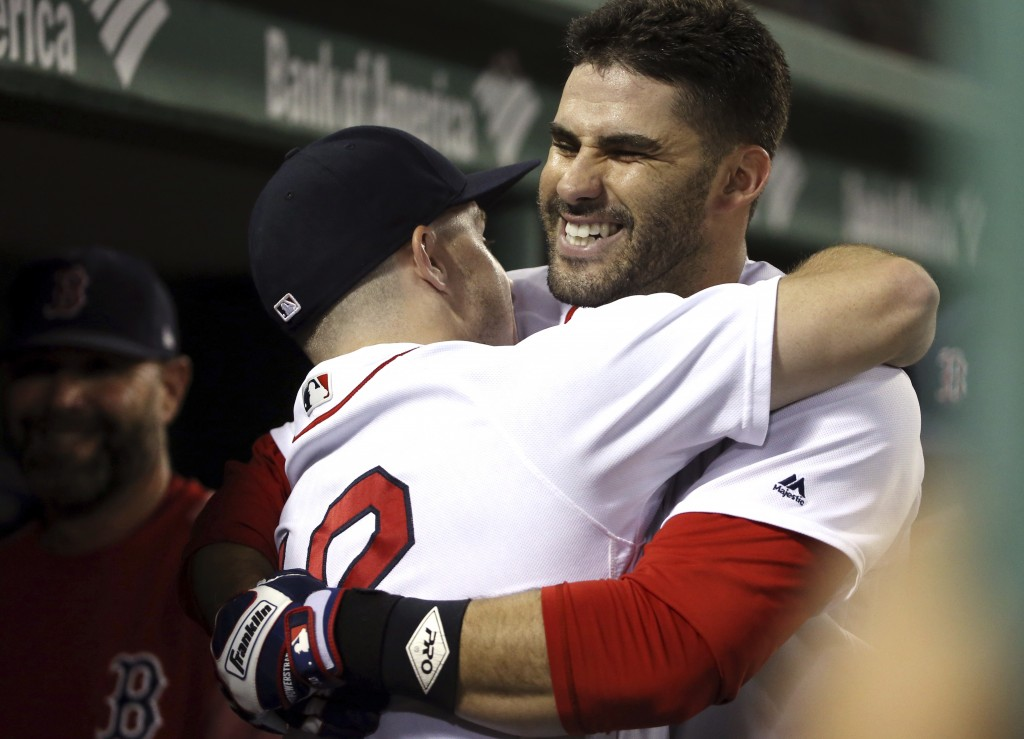 Boston Red Sox's J.D. Martinez celebrates his solo home run with Brock Holt in the dugout in the second inning of a baseball game against the Toronto